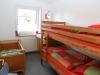 Schlafzimmer mit Etagen- und Kinderbett